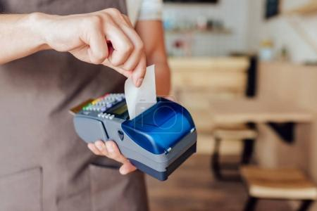Photo for Cropped shot of waiter receiving payment with credit card and terminal - Royalty Free Image