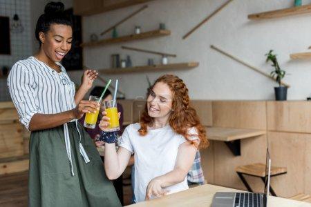 multiethnic girls drinking juice