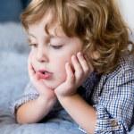 Close-up portrait of adorable pensive little boy l...