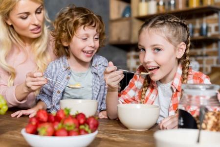 mother with kids having breakfast