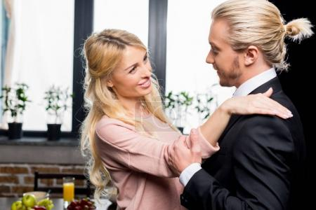 Businessman with wife at morning