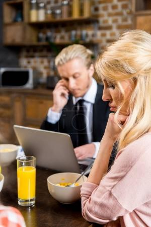 upset woman with husband during breakfast