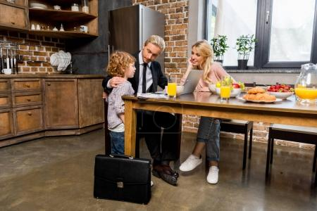 businessman with family at morning