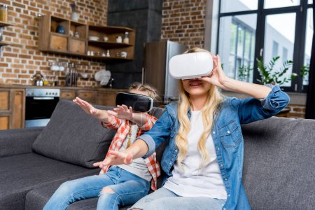 mother and daughter in vr headsets