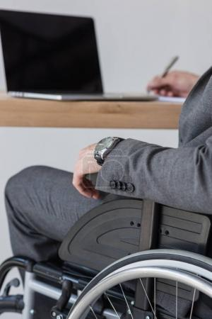 disabled businessman working in office