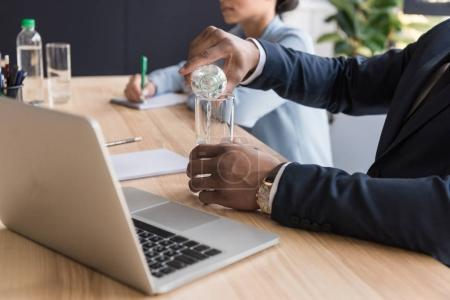 african american businessman pouring water