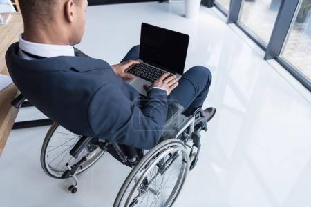 disabled african american businessman with laptop