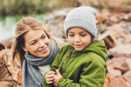 Photo for Happy young mother and son spending time together on nature - Royalty Free Image