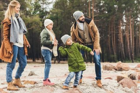 Photo for Happy family spending time together on nature on autumn day - Royalty Free Image