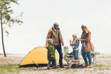Photo for Beautiful family having camping trip on cold cloudy day - Royalty Free Image