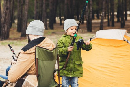 Father and son with fishing rods
