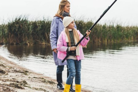 Mother and daughter fishing together