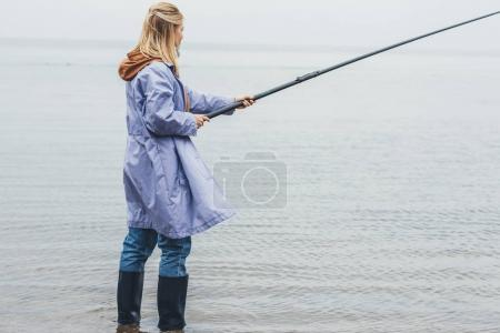 woman fishing on cloudy day