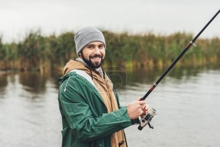 man fishing on cloudy day