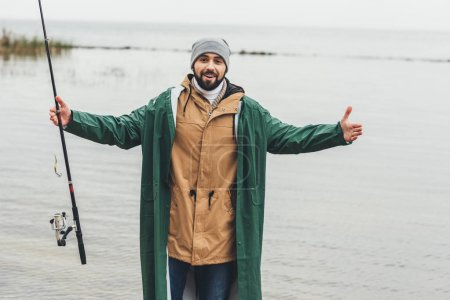 man showing size of fish