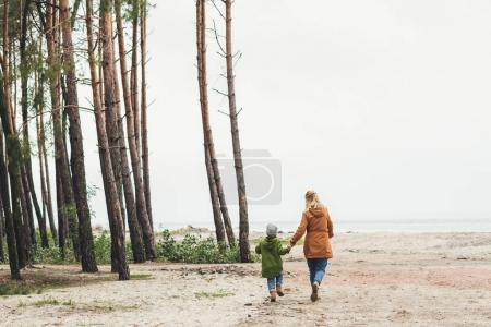 mother and son walking together on nature