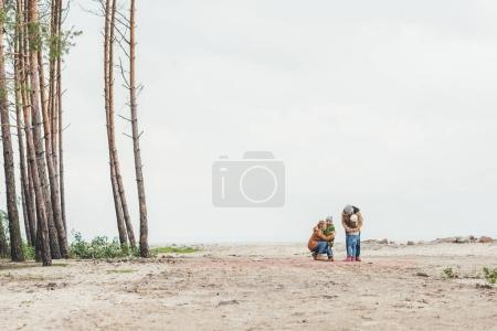 family embracing on nature
