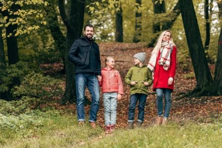 Family walking in autumn park