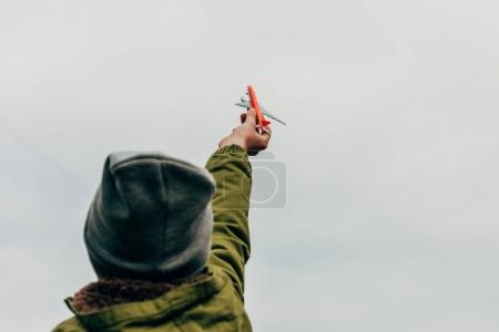 boy holding toy plane