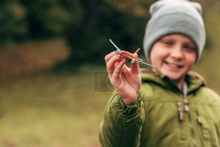 Boy holding toy plane