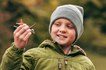 Child holding toy plane