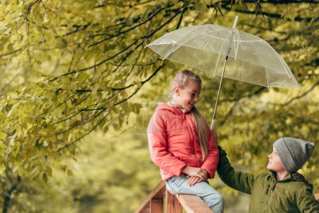 Kids with umbrella in park