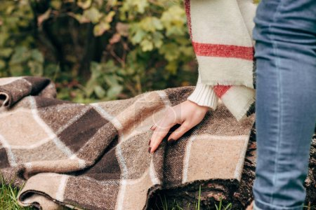 Girl with plaid in park
