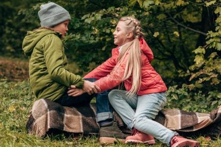 Children holding hands in park