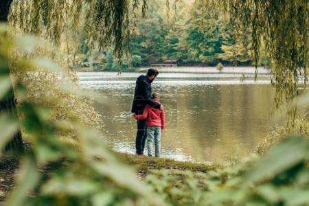 father and daughter near lake