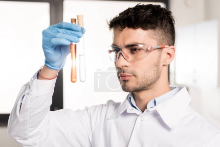 scientist holding test tube