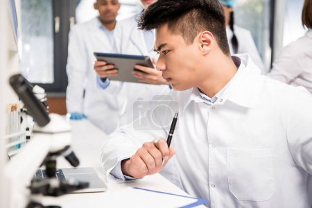 scientist using laptop
