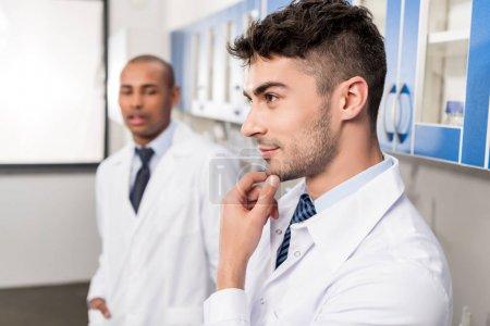 Handsome medical worker in lab coat