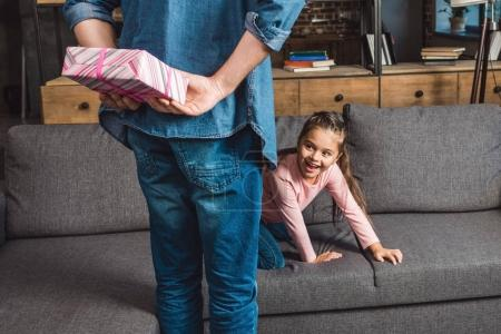 father presenting gift for daughter