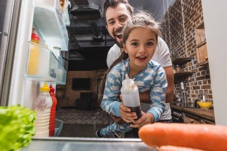 Father and daughter looking for food