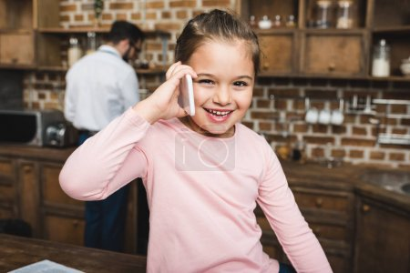 child talking by phone