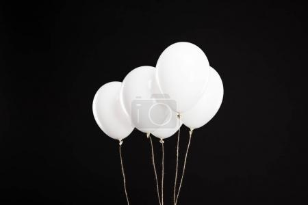 Bundle of white balloons