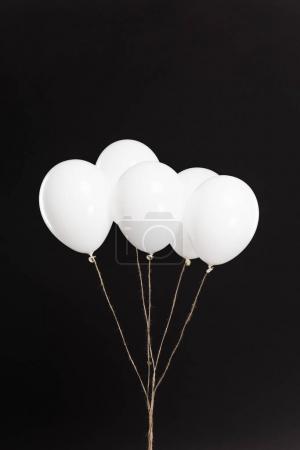 Bundle of white balloons