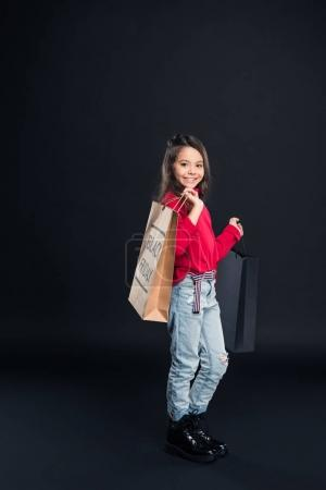 kid holding shopping bag