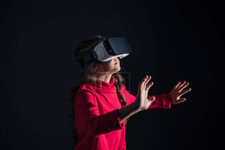 Child with VR headset touching something