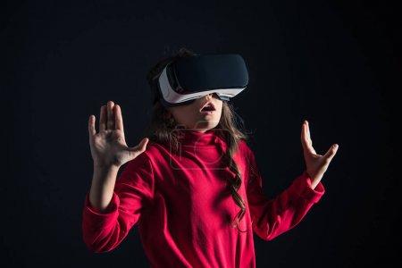 Surprised kid in VR headset