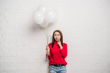 woman with helium balloons