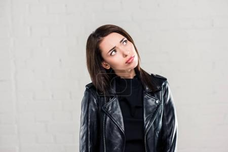 Upset woman in leather jacket