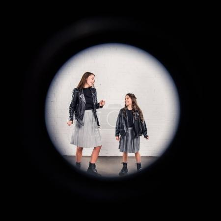 Mother and daughter through round frame