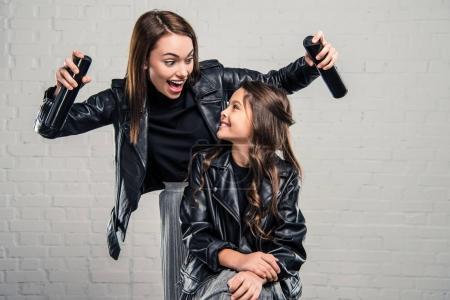 Mother holding hair sprays