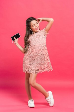 Child singing and dancing with smartphone