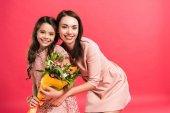"""Постер, картина, фотообои """"мать и дочь с букетом цветов"""""""