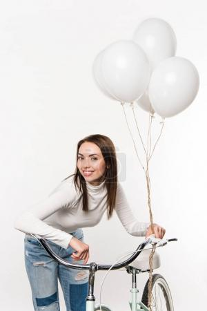 woman leaning on bike with balloons