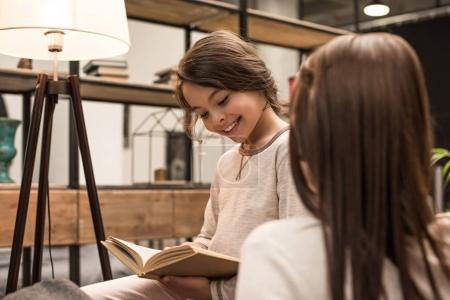 smiling daughter with book