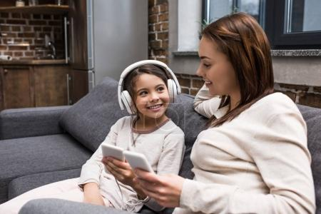 daughter listening music in headphones