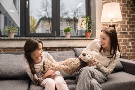 family fighting over teddy bear